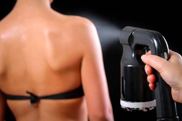 Lady getting a spray tan